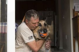Retired Army Sgt. Toby Yarbrough hugs his German Sheppard service dog, Duke, age 13.