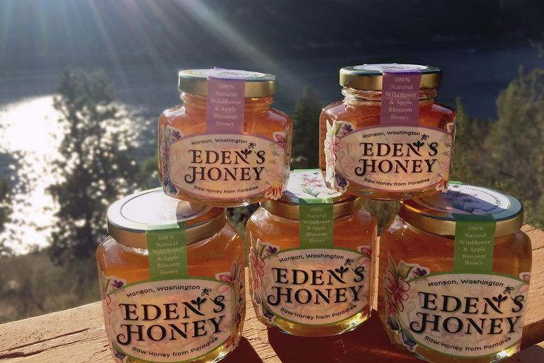 Eden's Honey jars setup with lovely Lake Chelan in the backdrop.