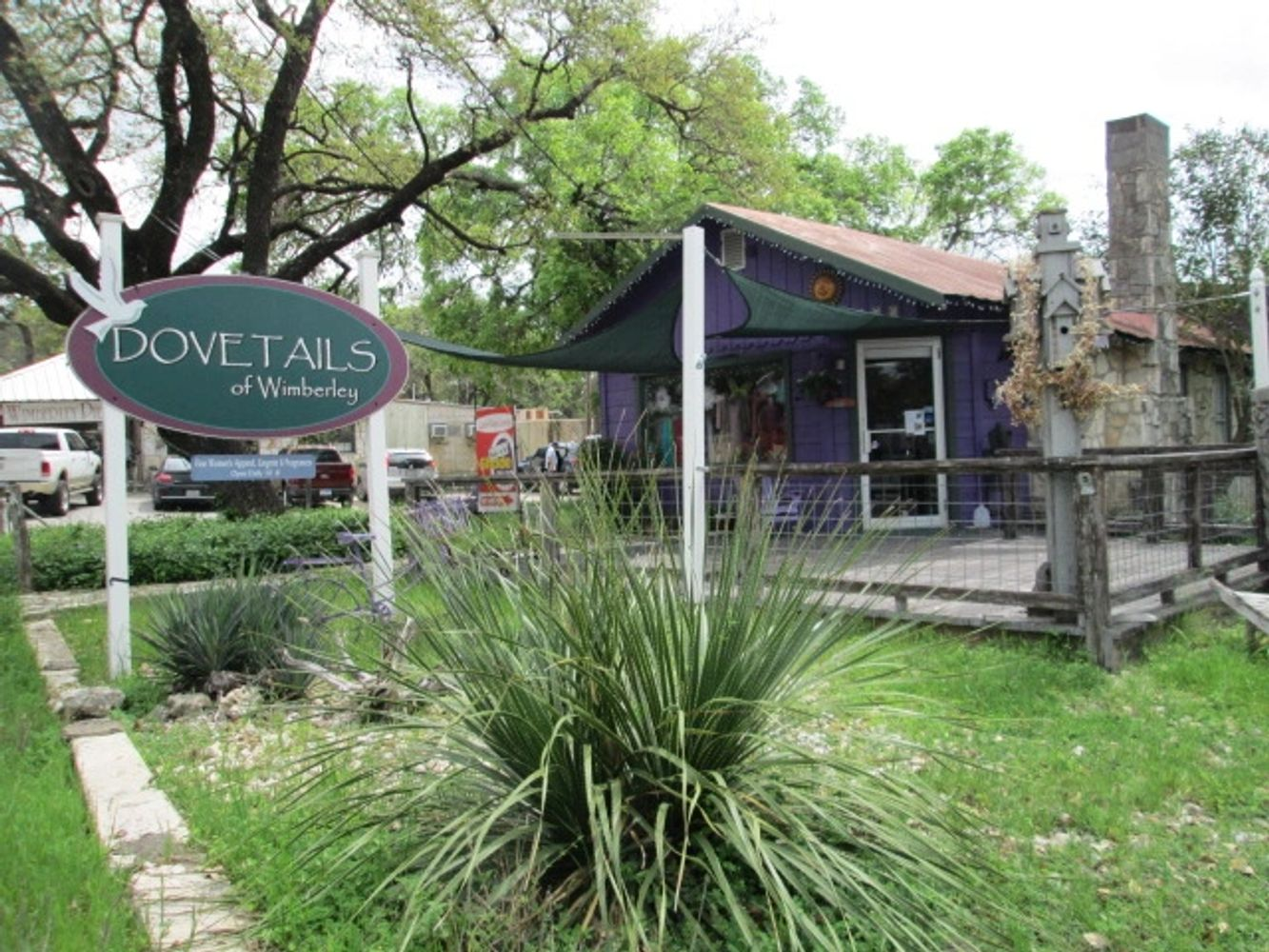 The purple house with the green canopy 1 block south of the Square in beautiful Wimberley, Texas.
