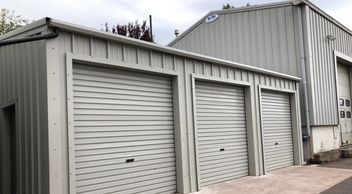 Large double. triple and industrial buildings for storage and workshop use.