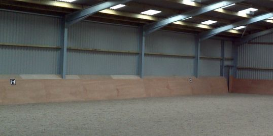 Indoor covered all weather riding arena school
