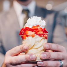 Pineapple Dole Whip topped with fresh strawberries and whipped cream. Heavenly!