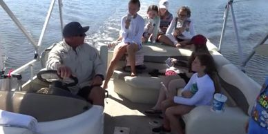 Captain Randy takes Tampa kids on a pontoon boat at Weedon Island for Mangrove Marcus Summer Camp