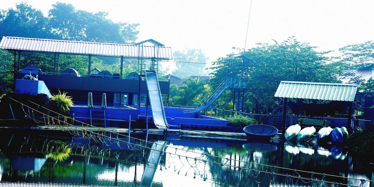Kingfisher Dandeli Resorts with Lake and swimming pool view and dandeli Jungle View Cottages.
