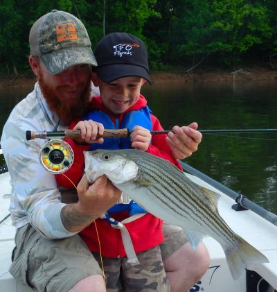 Andy Bates fishing with his son