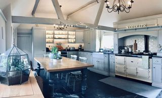 Bespoke kitchen painted in Farrow & Ball 'Purbeck Stone' with black limestone floor.