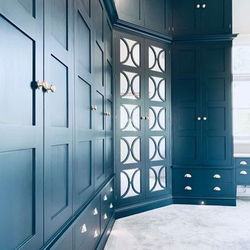 Bespoke wardrobe hand painted in Farrow & Ball 'Hague Blue' with mirrored doors and brass handles