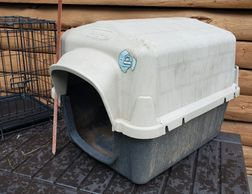 Dog House #1 is a Top Paw doggie house it is 20 x 18 x 23  in a heavy molded plastic
