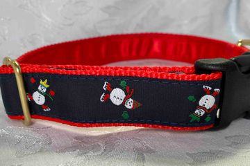 Snowmen ice skating on black with red web collar.