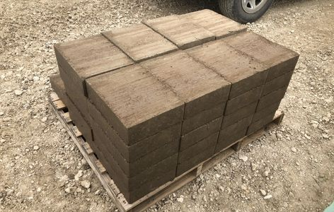 "A pallet of freshly-made 10"" x 14"" CEBs"