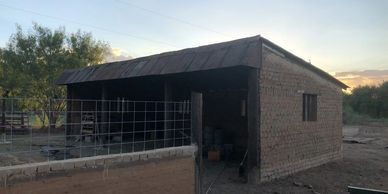 Earth block barn before earthen plaster goes on