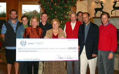 A check presentation from the deLeuze family to the endowment.