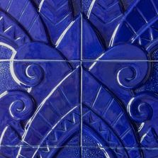 Hand-carved Art Deco tile set with cobalt blue glaze