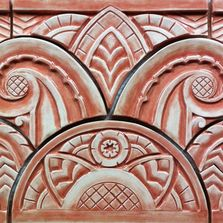 Symmetrical hand-carved Art Deco relief tile set