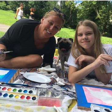 mom and daughter with Pug in NYC Central Park Sip and Paint Your Pet Portrait Fun party