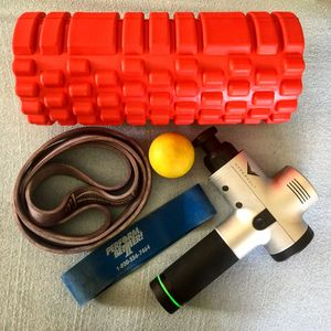 Recovery session using a foam roller, mobility band, and Hypervolt massage device.