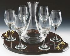 Wine decanter set carafe on a wooden tray with glasses