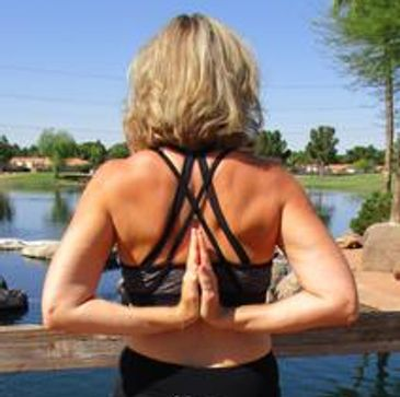 Renee Johnson, yoga instructor performing reverse namaste, prayer position in Freestone Gilbert AZ