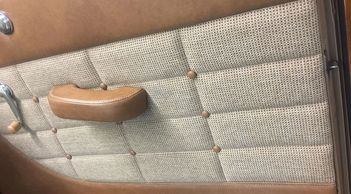 tufted button door panels with leather and custom stitching
