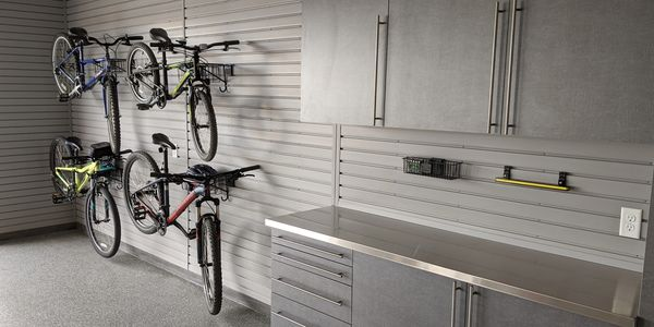 Pewter Garage Cabinets with a stainless steel countertop and slatwall