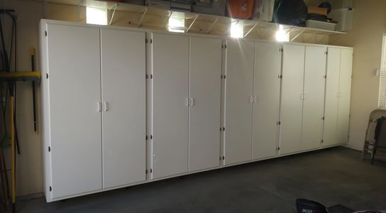 White Melamine MDF Cabinets. 7 ft tall x 4 ft wide x 2 ft deep.