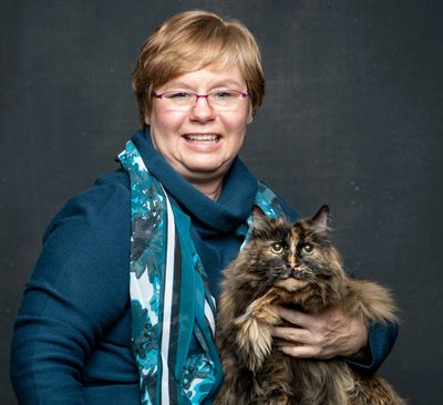 Beth Pasek, Cat Behavior Consultant, and her cat Lucy.  Photo by: Greg Murray Studios