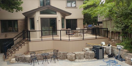 Deck built in Mississauga with Trex Transcends decking.  Pools, Landscaping and patio also included
