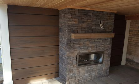 Trex rainescapes with fireplace underneath in Burlington, On. Decking was also Trex decking oakville