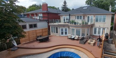 Deck built in Toronto 2019 on lake Ontario. Includes roof decking, custom railing and privacy fence