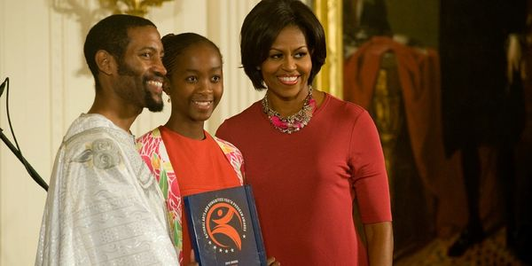 Dr. Ayize and Michelle Obama at a White House Award Ceremony