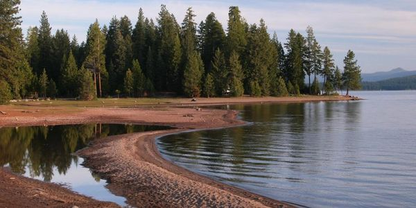 The Sage Creek Insurance Services office is located near beautiful Lake Almanor shown in this photo