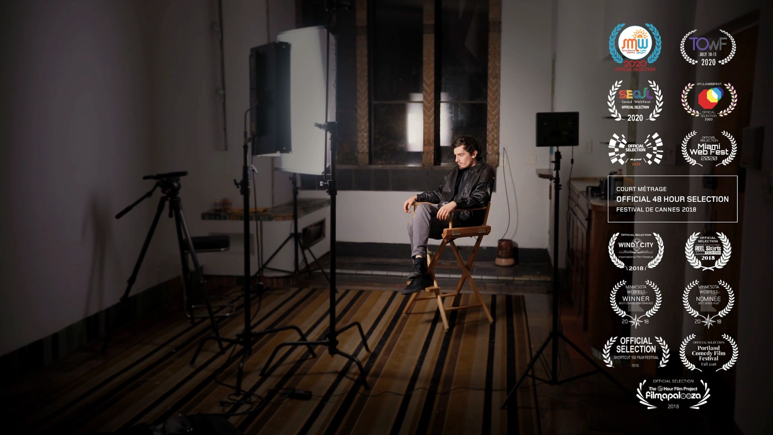 Filmmaker sits in director's chair on set BTS interview, patiently awaits his fame & fortune.