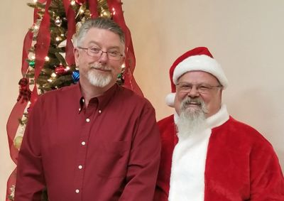 Board member Jay attempting to convince Santa he was good all year.