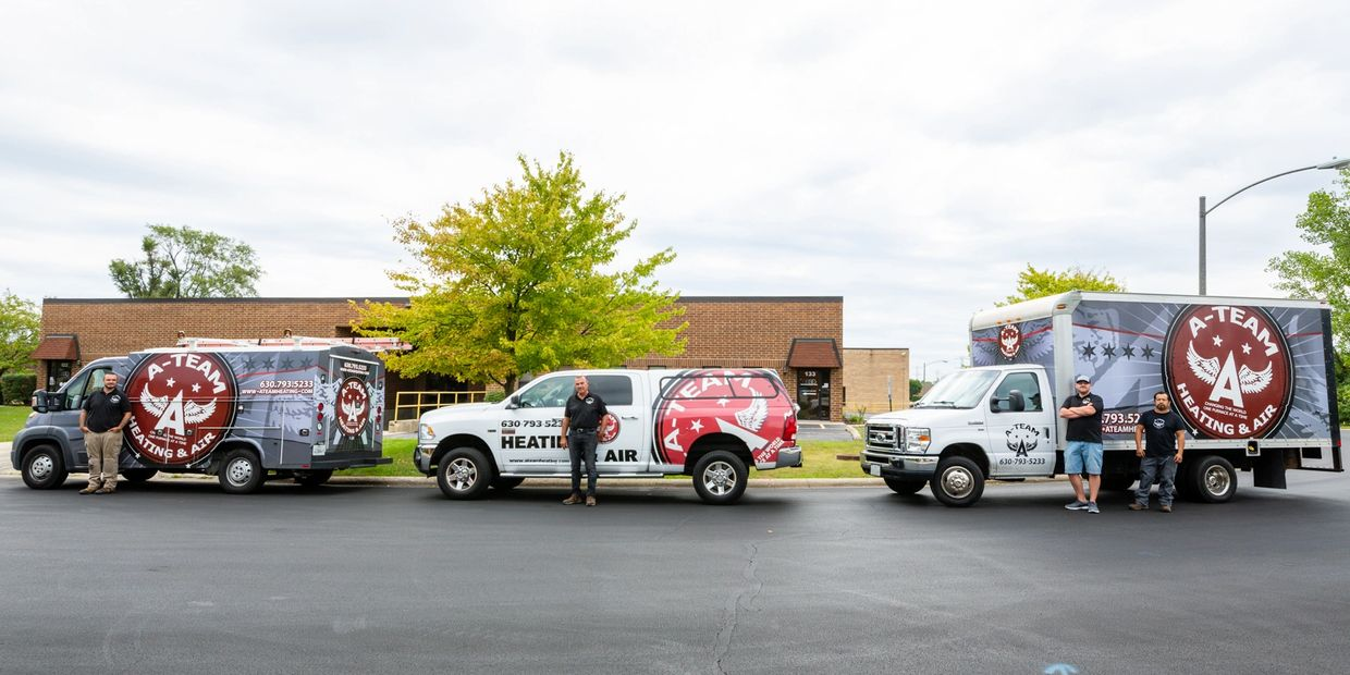 Three of our trucks and some of the members of A-Team Heating and Air Conditioning.