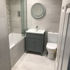 bathroom installation. porcelain grey tiles