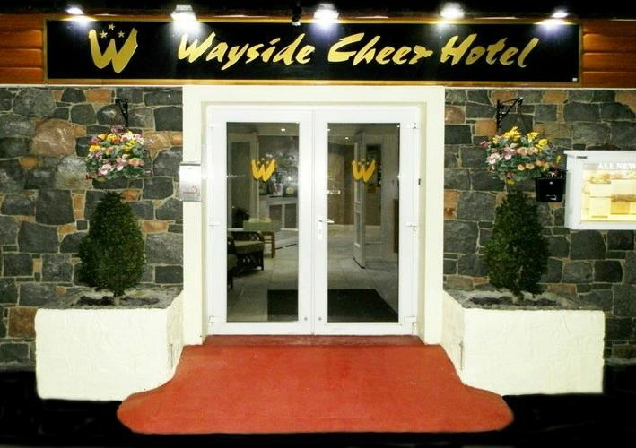 Front Entrance of the Wayside Cheer Hotel