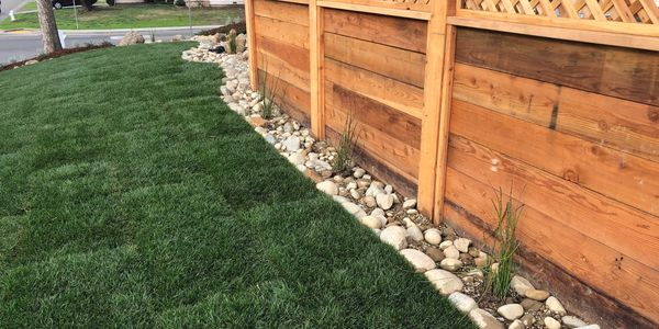 Redwood fence with sod lawn