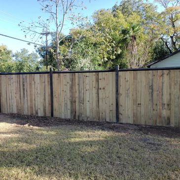 Metal framed privacy fence with gate opener