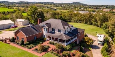 A stunning 6-bedroom, 7.5 bath home sits on 2.77 acres. 5 car garage plus RV parking. 7066 sq. ft