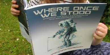 Reading a copy of Where Once We Stood