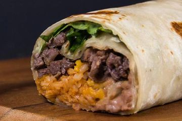 "12"" Flour Tortilla filled with bell peppers, onions, cheese blend and your choice of: Chicken or Por"