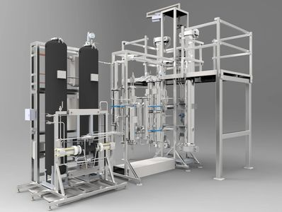 A supercritical carbon dioxide extraction device is shown with its bright stainless steel vessels at