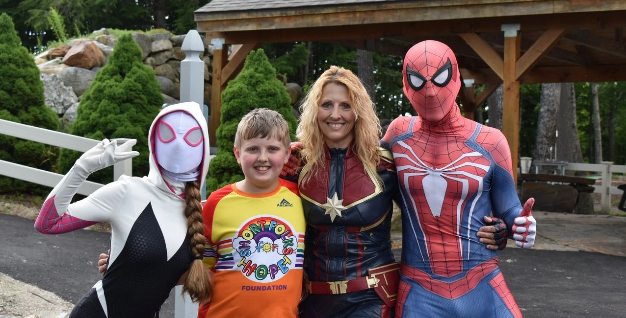 Our Supers For Hope - Spider Gwen, Youth Ambassador Isaiah, Captain Marvel and Spider-Man.