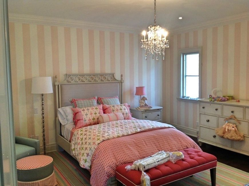 Interior girls bedroom featuring pink striped wallpaper