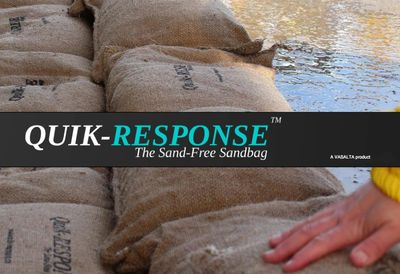 Quik-Response self-expanding sandbags protecting against flooding