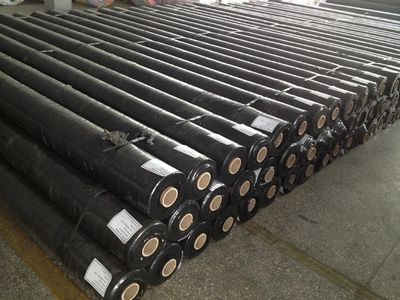 Rolls of geotextile fabric in warehouse