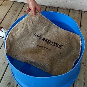 Submerging Quik-response self-expanding sandbag in water for activation.