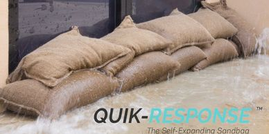 Quik-Response self-expanding sandbags protecting a home from flooding.