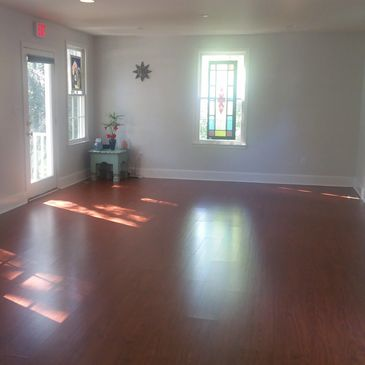 Our sunlit and spacious yoga room where we offer yoga for all levels.