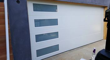 smooth flush panel garage door - best price garage door service - 818-431-7520